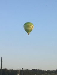 Hot-air balloon floating by|by Chris Mercury